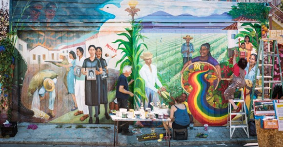 Artists work on a  mural in Balmy Alley - a cultural heritage site located in San Francisco, CA.